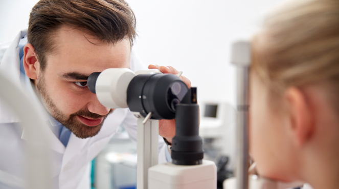 Ophthalmologist examining a patient's eye