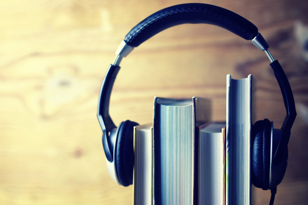 Headphone on a side stack of books.