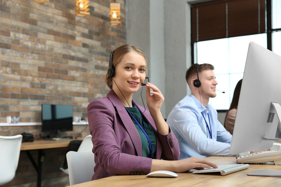Technical Support Operator Working With Colleagues In Office