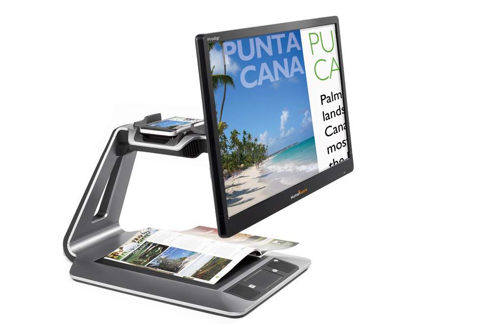 A desktop magnifier enlarging the text and image of a magazine.