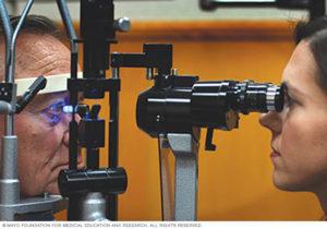 Woman giving man eye pressure test