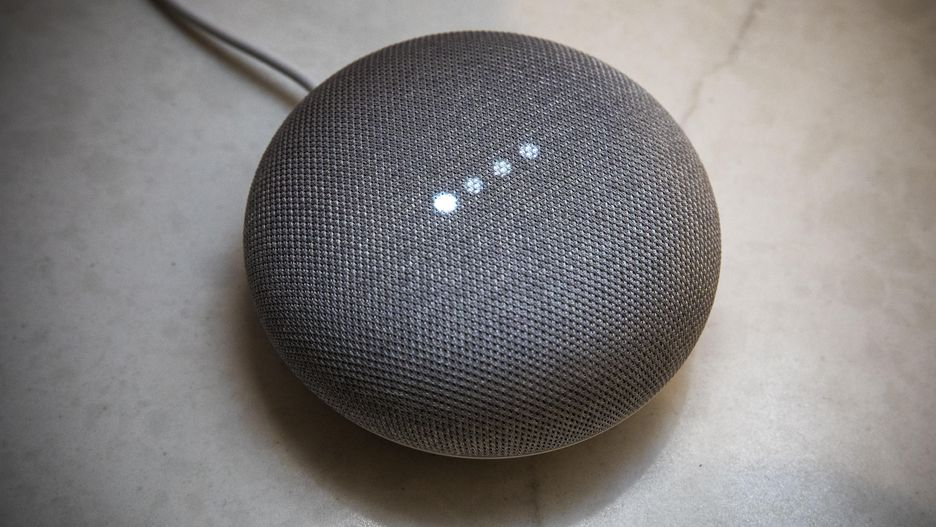 A gray Google Home Mini
