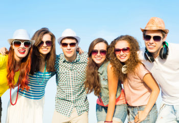 Group of people all wearing sunglasses