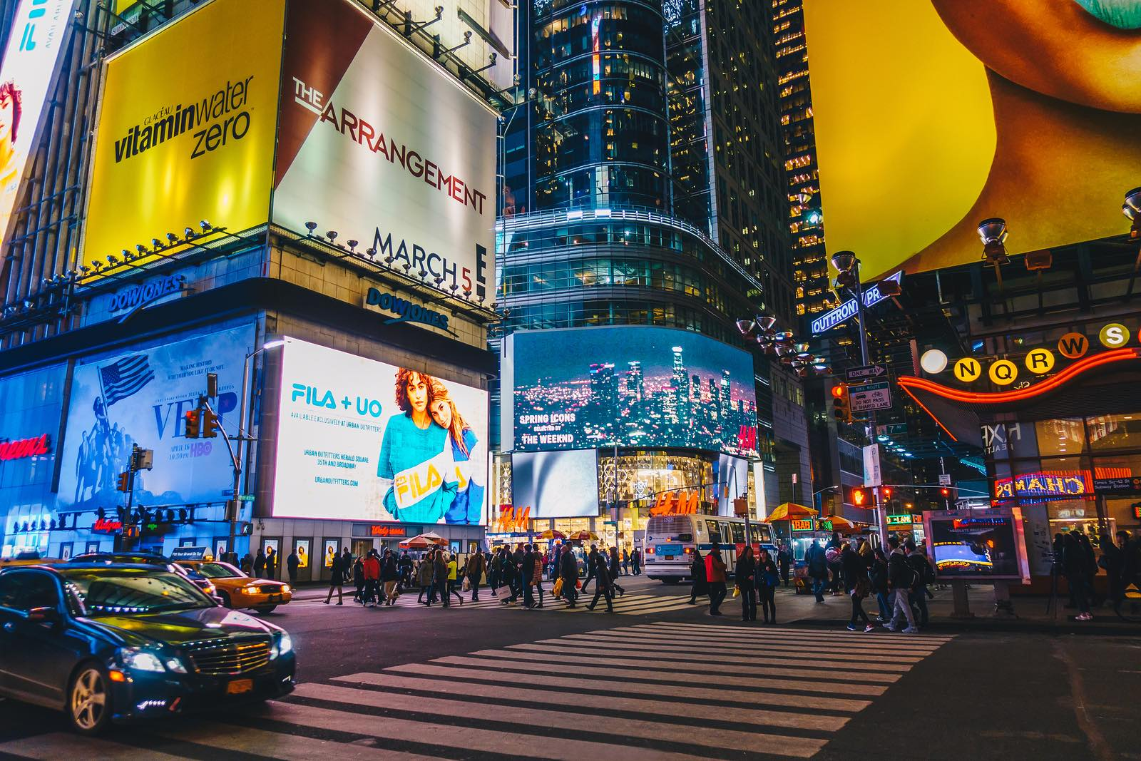 Times Square's animated colorful LED lights and Broadway theaters in New York City.