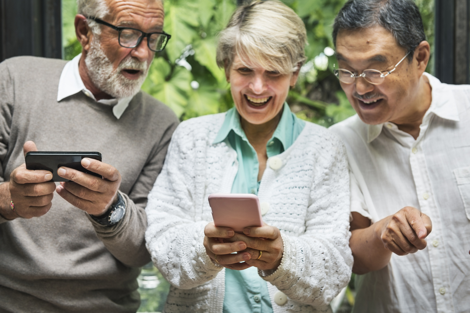 Group Of Senior Retirement Using Smartphone