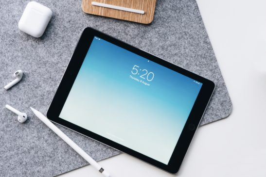 ipad and apple products on a gray mat