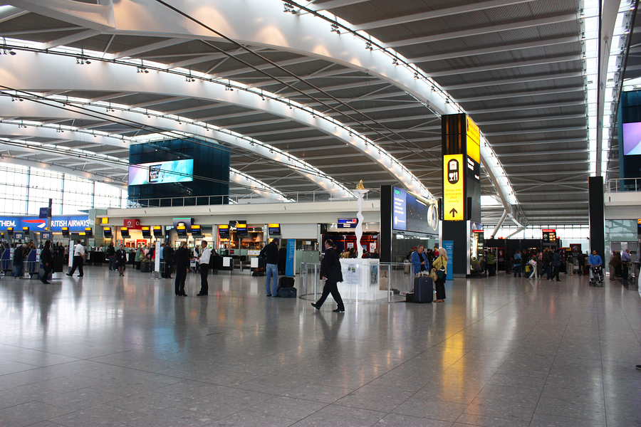 Travelers in London Heathrow Airport.