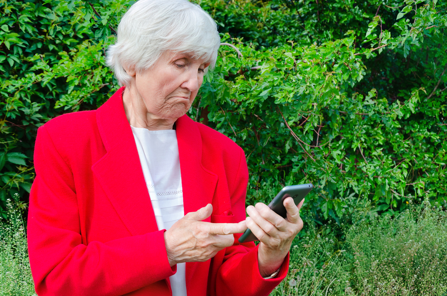Portrait Of Old Grandmother Use Technology Outdoors At Sun Day.