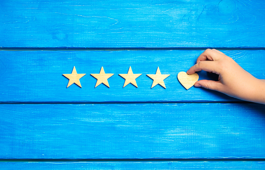 Four Stars And Heart On A Blue Background.