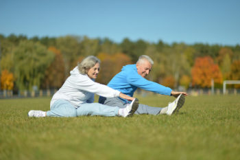 Image shows youthful seniors exercising outdoors.