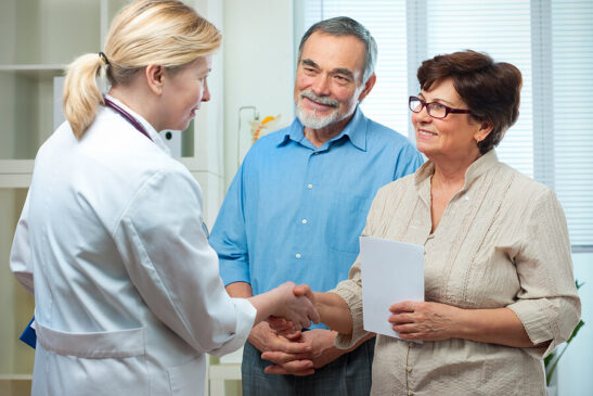 Couple meet with physician to discuss participation in clinical trial.