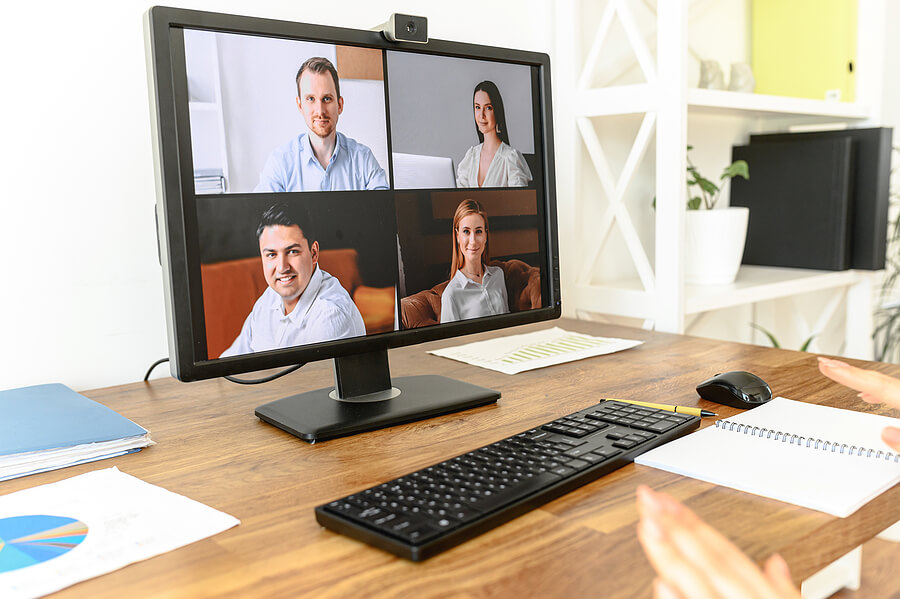 Image shows: large screen with video meeting participants