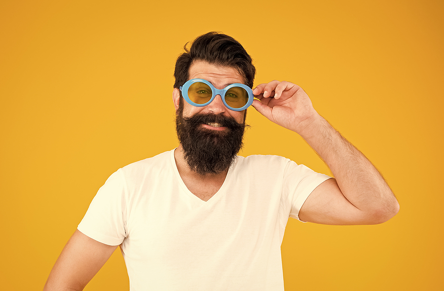 Image shows man wearing large protective sunglasses
