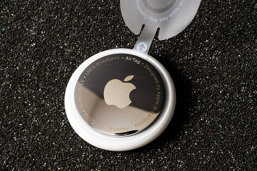 Image shows Apple AirTag in case with holder.